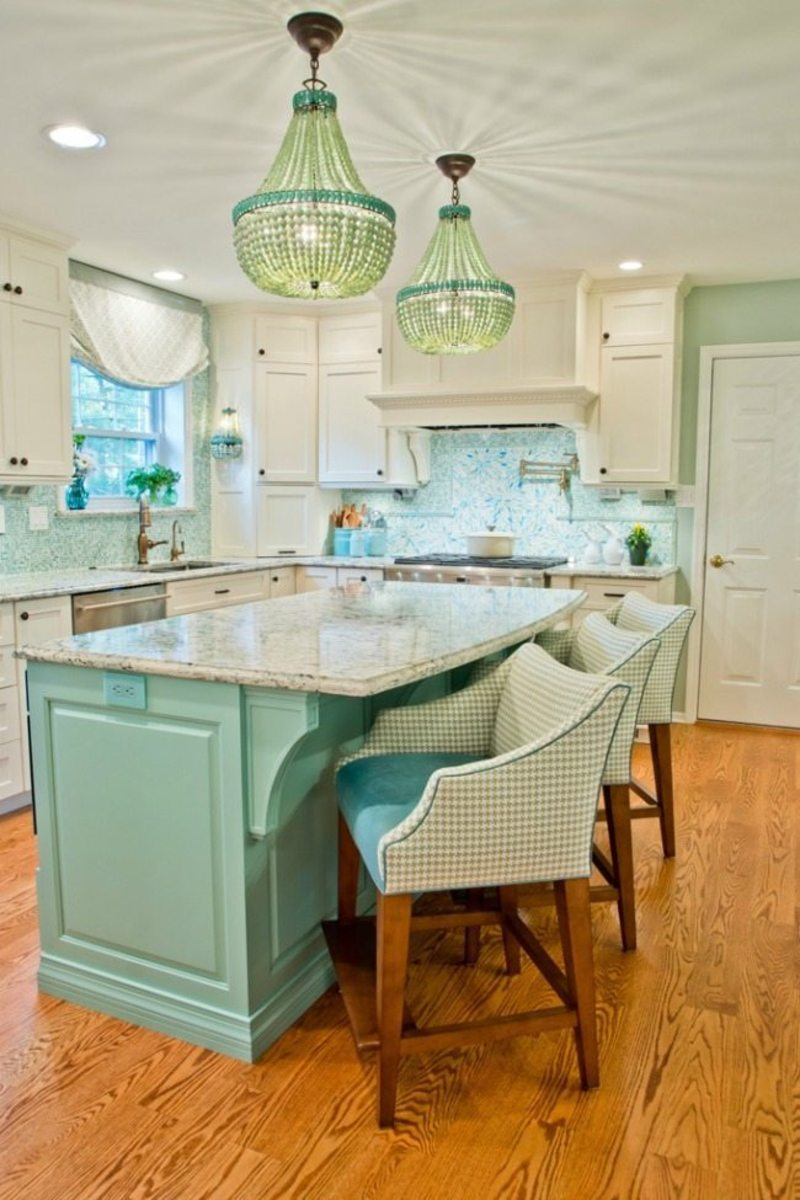 The turquoise and aqua kitchen is so beautiful, and they remind of all the shades you can see on the sand beach with the waves and the blue sky.