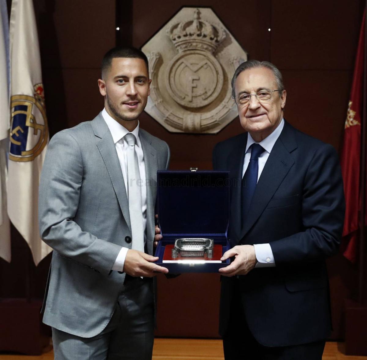 Hazard with Florentino Perez at his presentation.