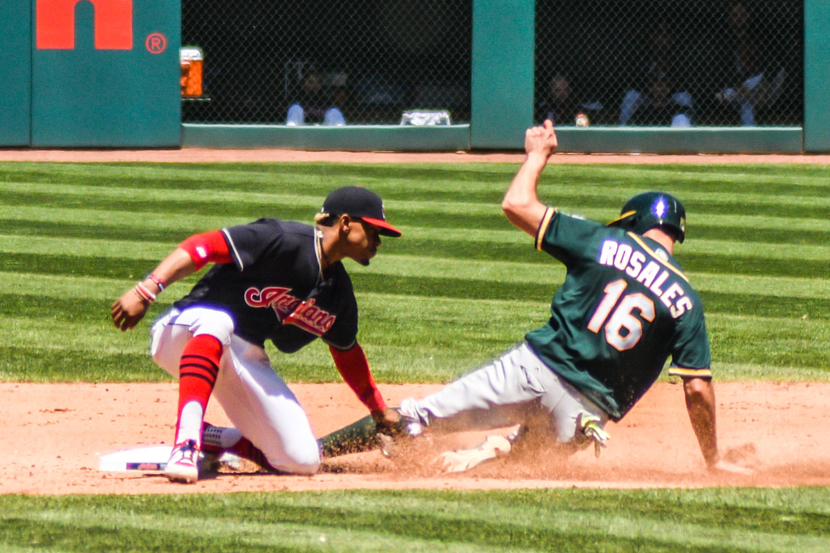 Francisco Lindor puts the tag on Oakland's Adam Rosales in 2017. Lindor only spent six seasons with the Indians, but he is one of the best shortstops in franchise history.