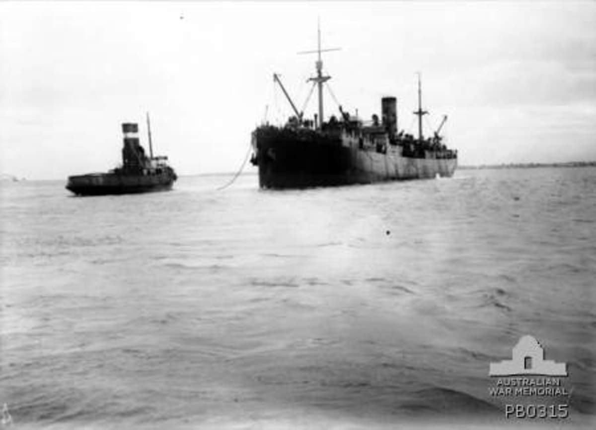 The HMAT Clan MacGillivray (A46) departing and being assisted by a tug. This was the ship that took my great grandfather to war.