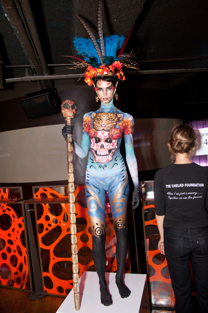 "body painting may be introduced into art gallery openings with the waiters and waitresses painted in fake ""clothing""."