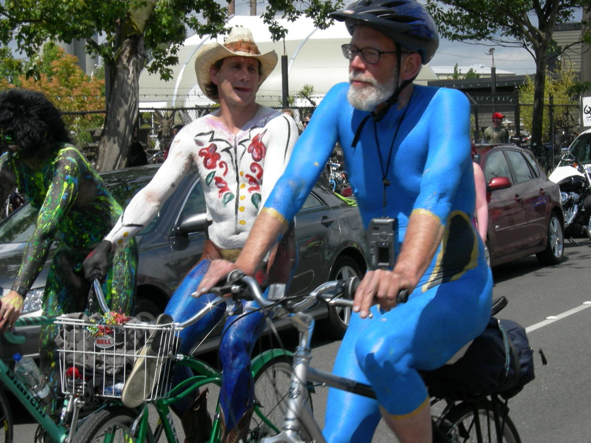 the traditional naked cyclist event in the summer solstice parade and pageant, Fremont Fair, Seattle, Washington.