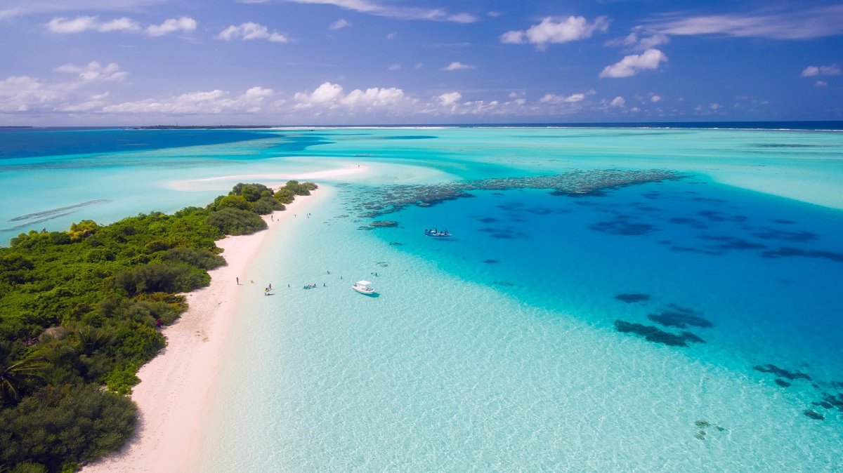 Paying your mortgage with a credit card may help earn travel awards that can get you to places like this lovely beach the Maldives.