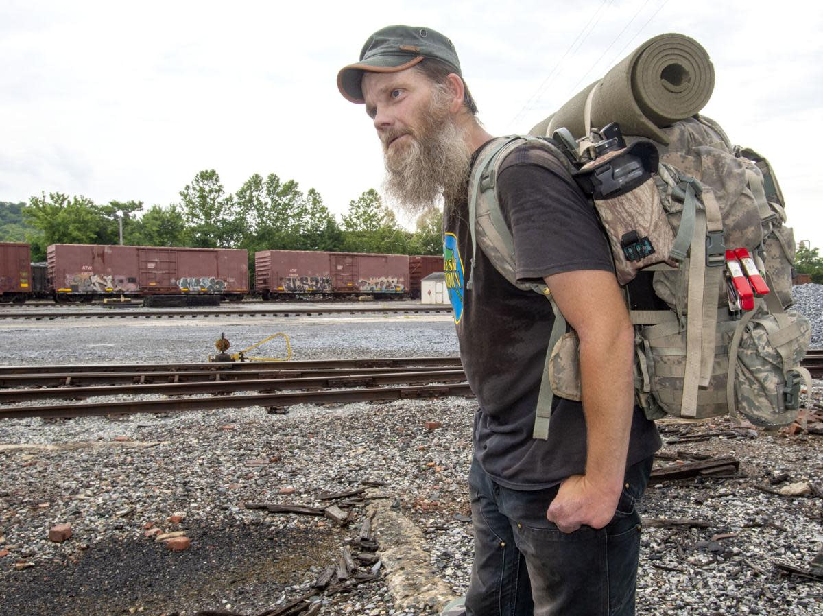 This hobo is happy that he can roam where he pleases, not pay taxes or other bills.