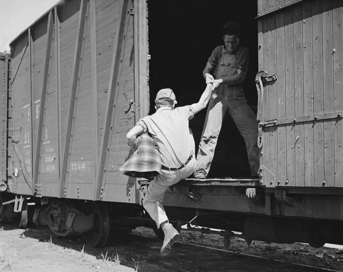 Jumping on a freight train was the best transportation for the hobo to travel for the hope of a job.