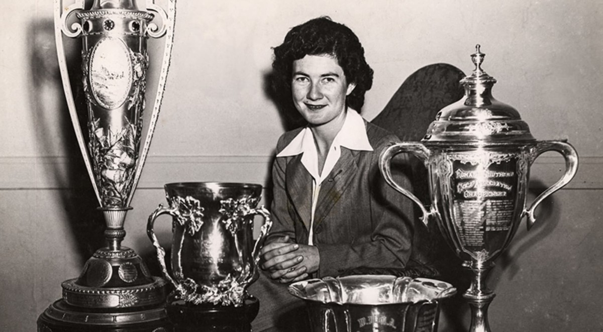 Louise Suggs  with some of her Trophies