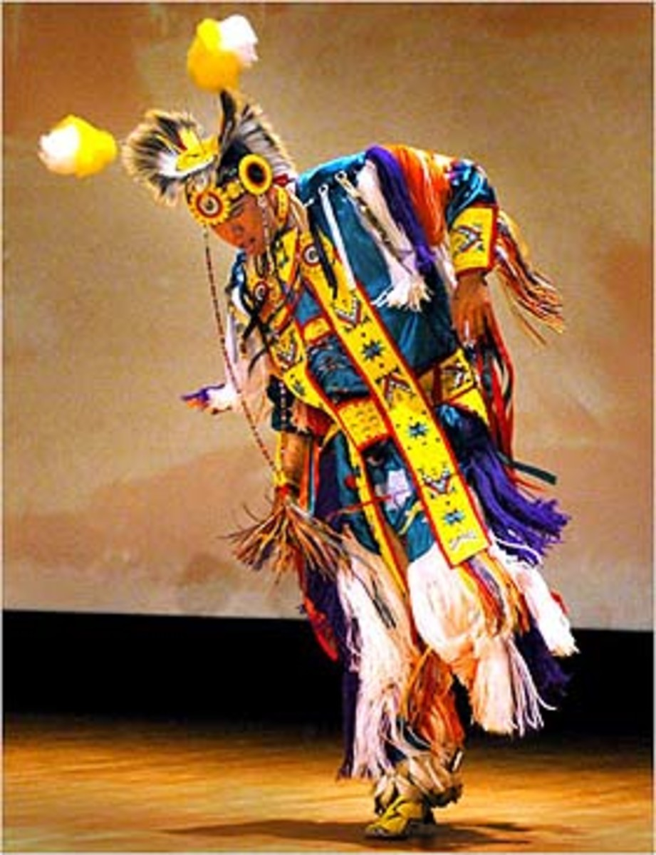 State Dept. photo by Ken White. Wylie Bearstail of the Hidatsa/Arikara tribes of North Dakota dances at the National Pow Wow.