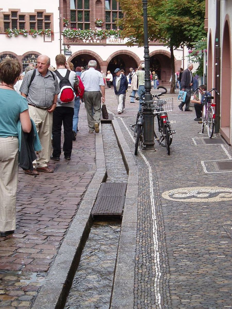 Rainwater runoff runs through channels in the streets of Freiburg.