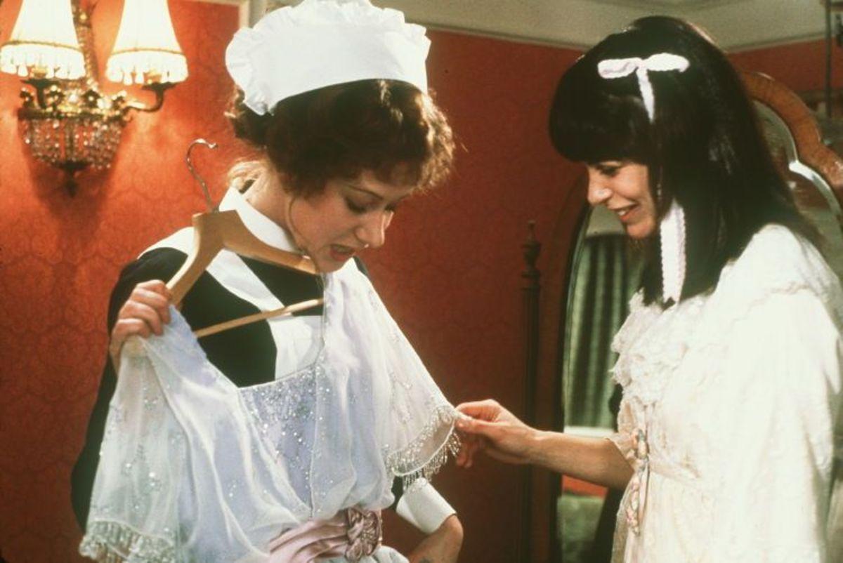 Stewardess May Sloan (Helen Mirren) admires Madeline Astor's (Beverly Ross) dress.