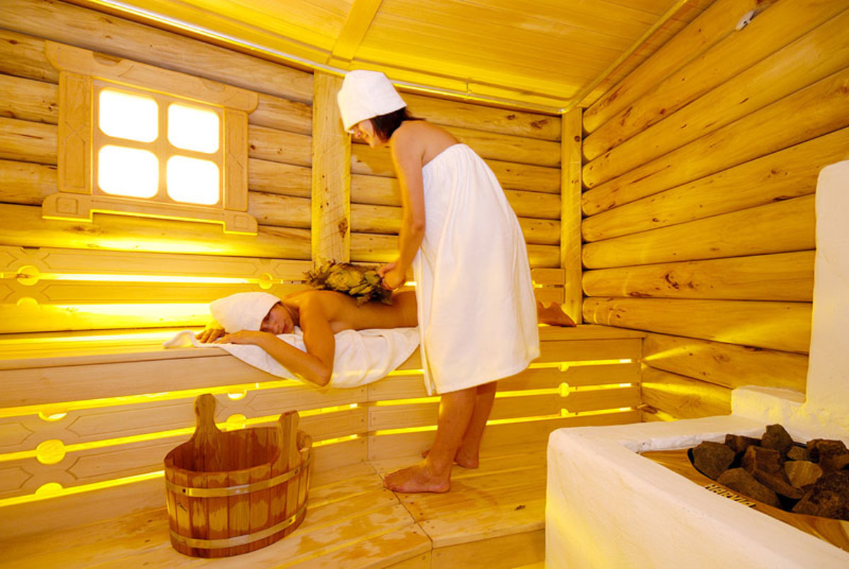 Beneficial twig massage in a Russian sauna.