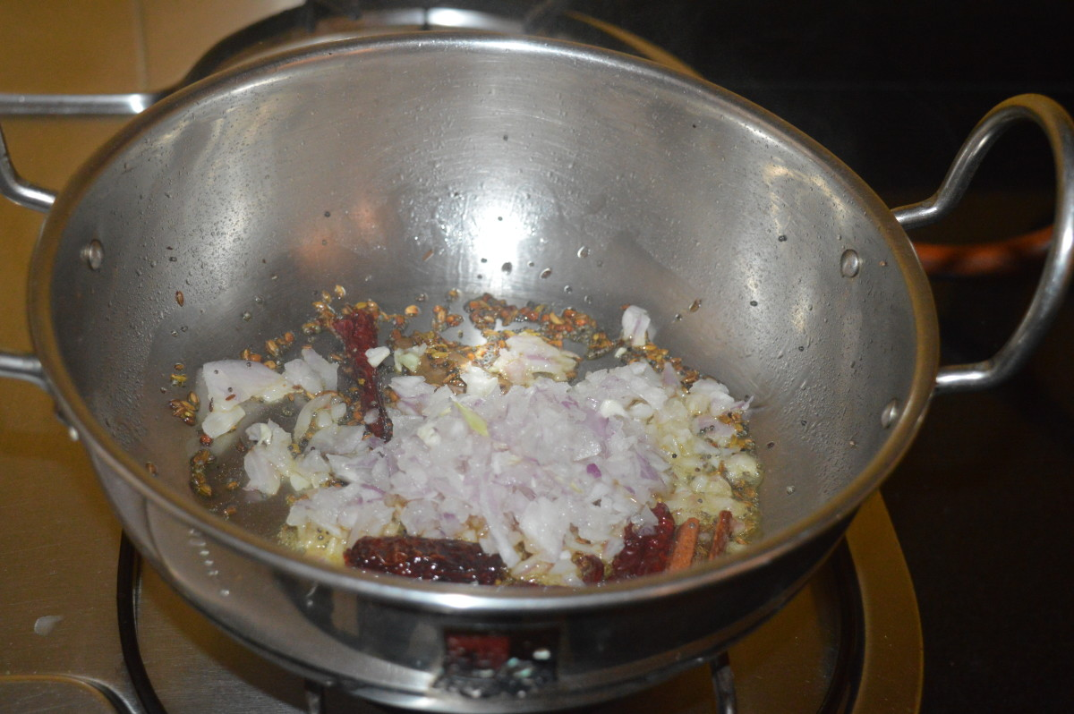 Step two: Add chopped onions. Increase the heat and saute until the onions become pinkish and transparent.