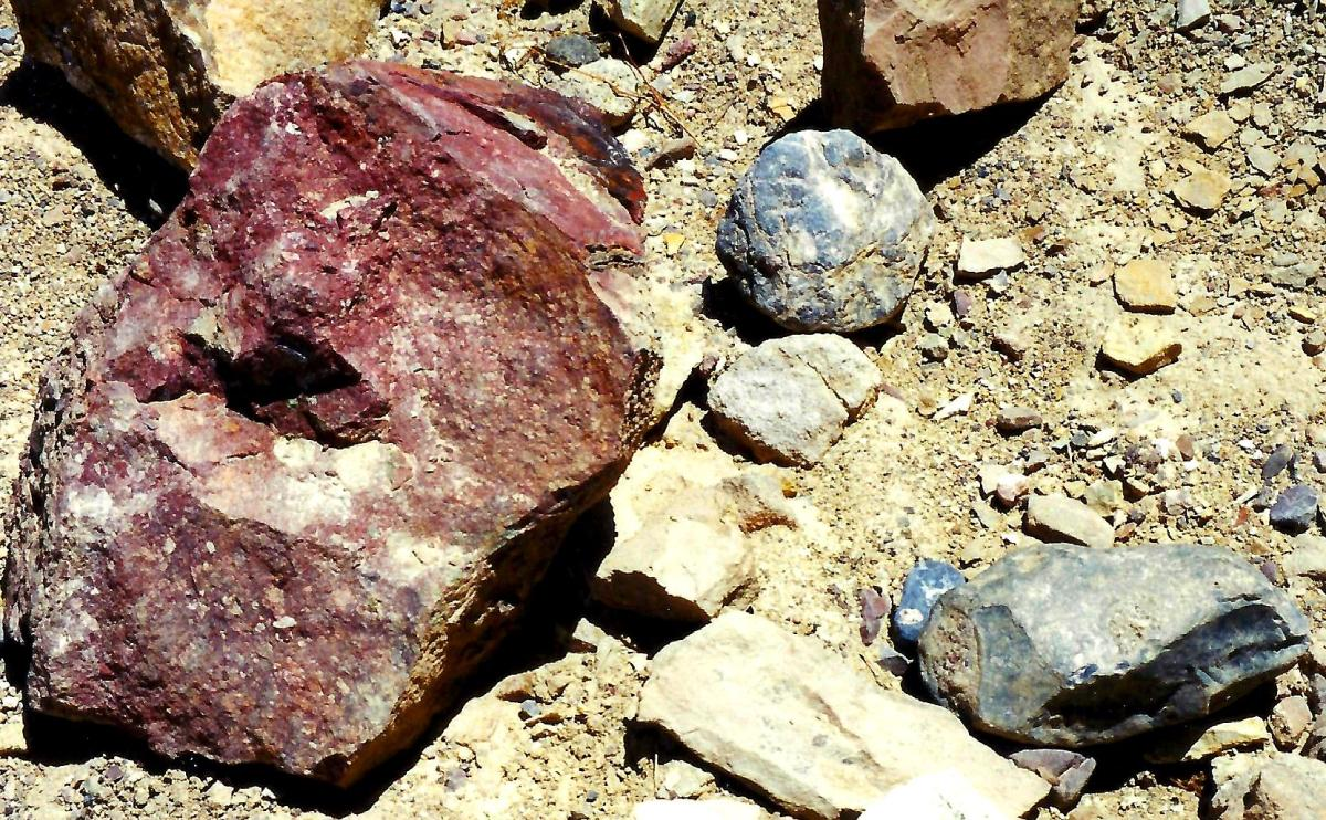 Closeup view of colorful rocks on the trail in Golden Canyon / Death Valley