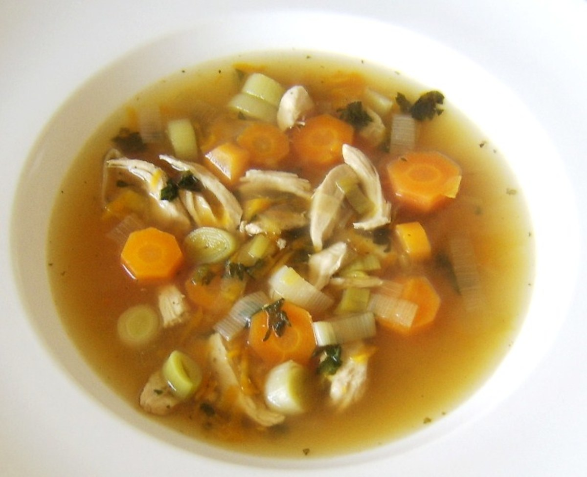 Leftover chicken, carrots and leek are the principal ingredients of this stinging nettle seasoned soup, which is served topped by homemade croutons