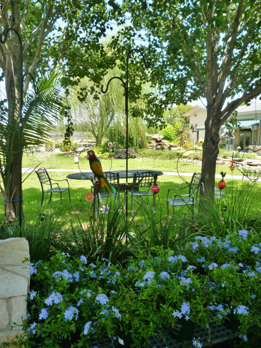 Pretty landscaping amidst the plants & other items for sale.