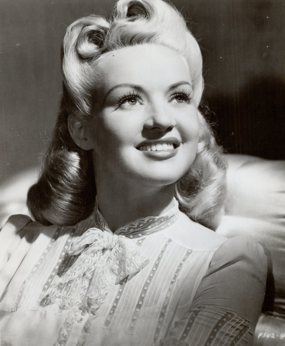 Film star Betty Grable with a long bob that included victory rolls and soft curled ends.