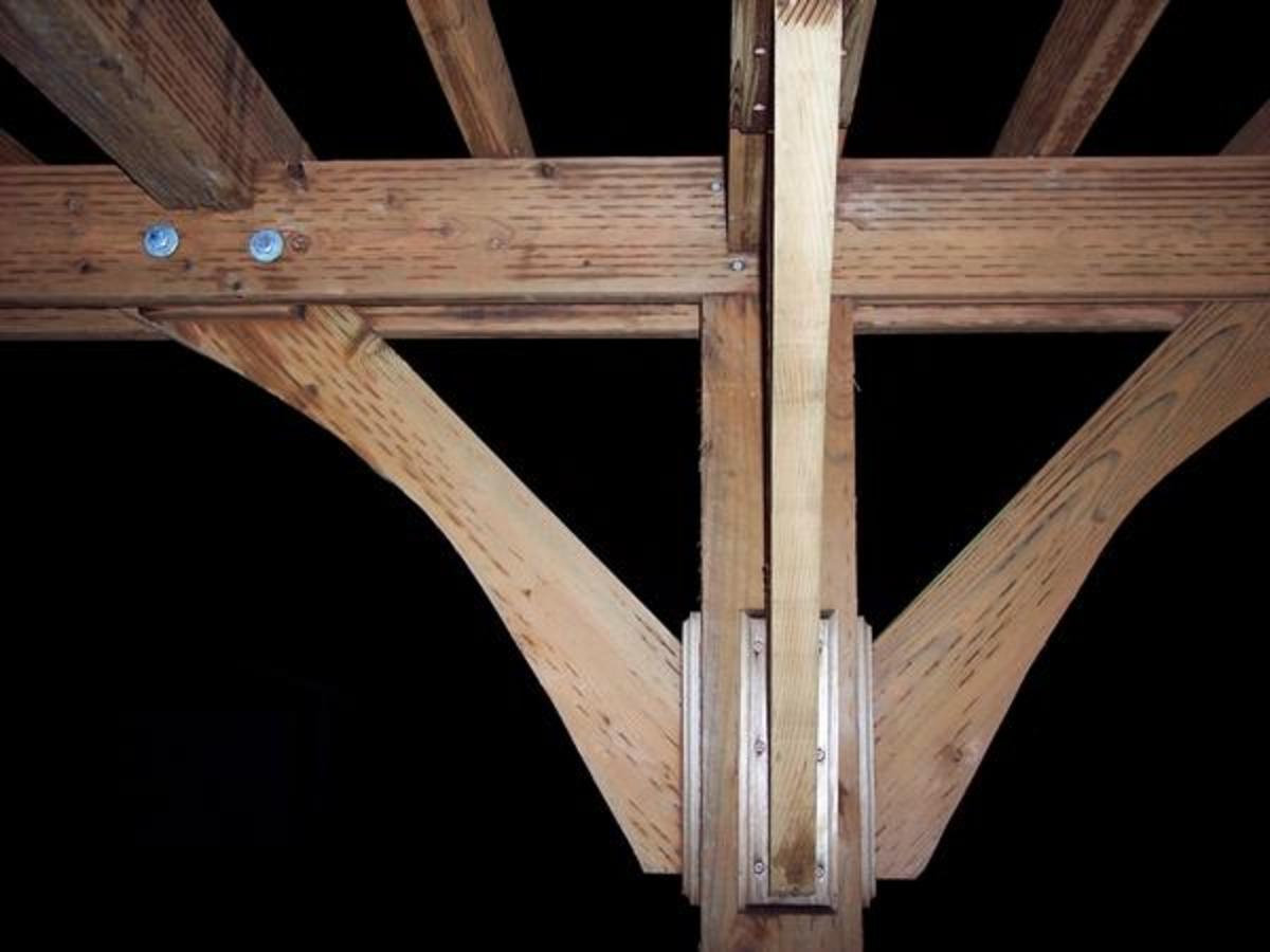 "The most basic stable structure is a triangle, a lesson I will never forget from our college ""bridge building"" contest (another story). So for this project, we cut some 2x12's into an arch shape and I fastened them between the 2x6 beams to form trian"