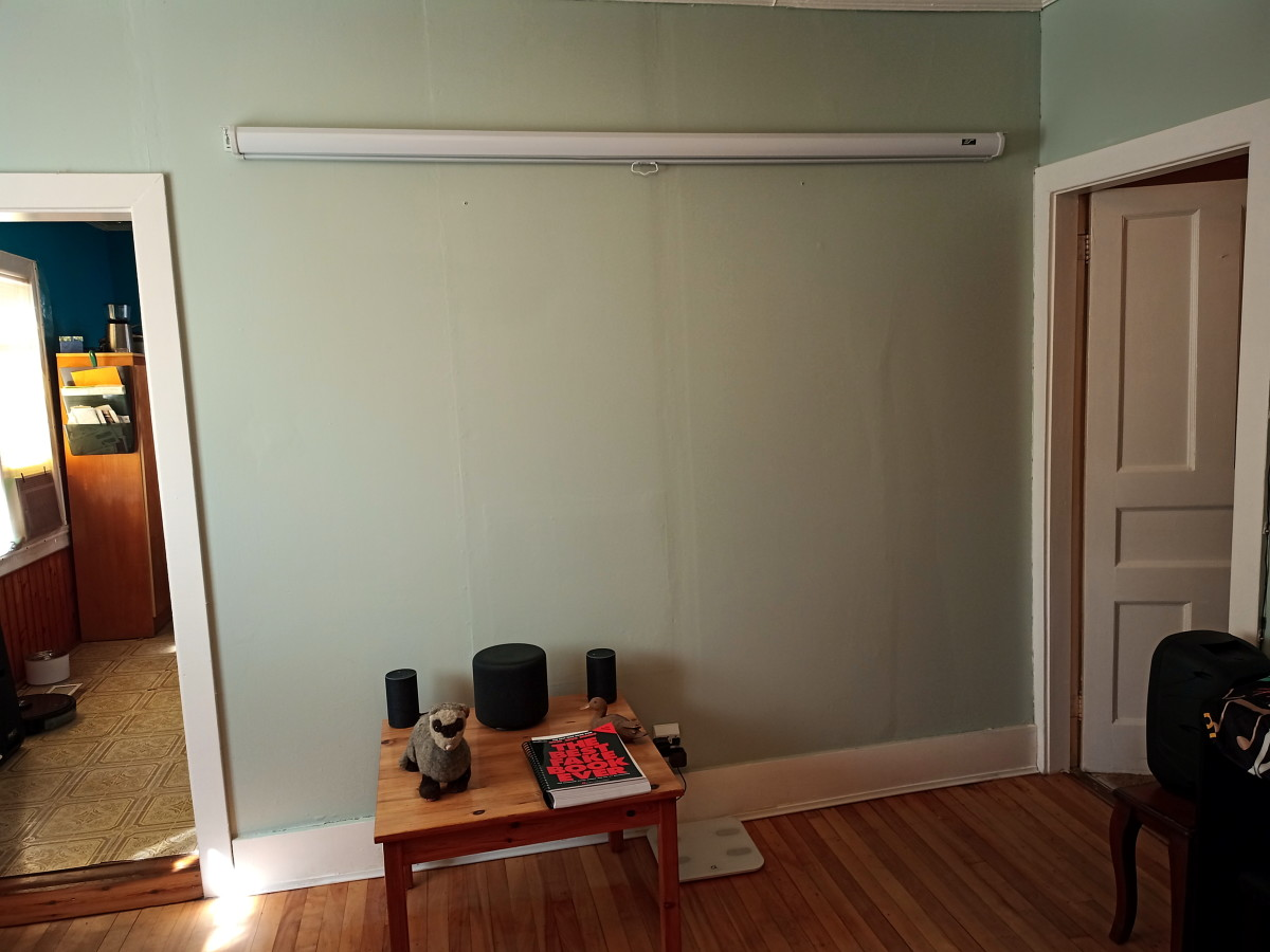 Projector screen rolled up and out of the way