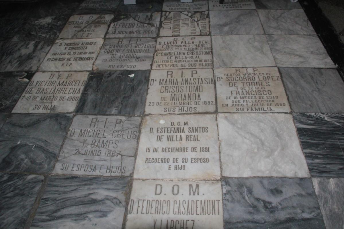 """Gravestones or """"lapidas"""" on the floor inside San Agustin Church (Photo by the author)"""