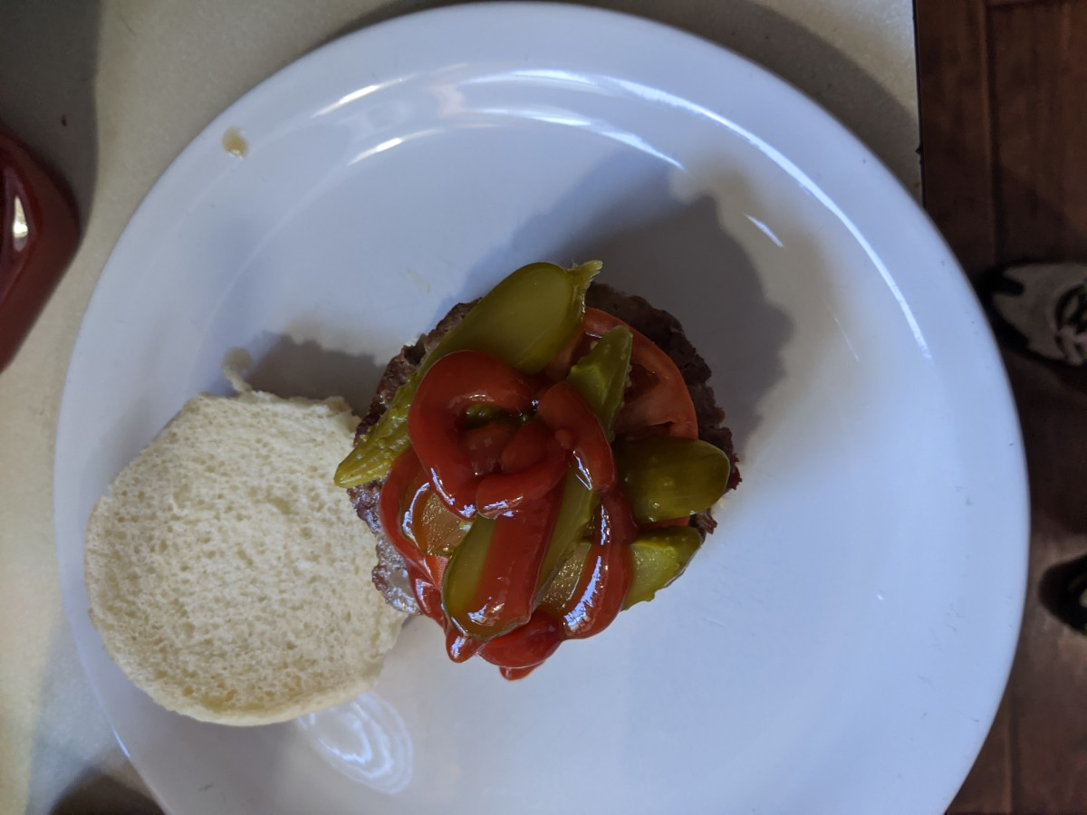 Normal burger with ketchup and pickles