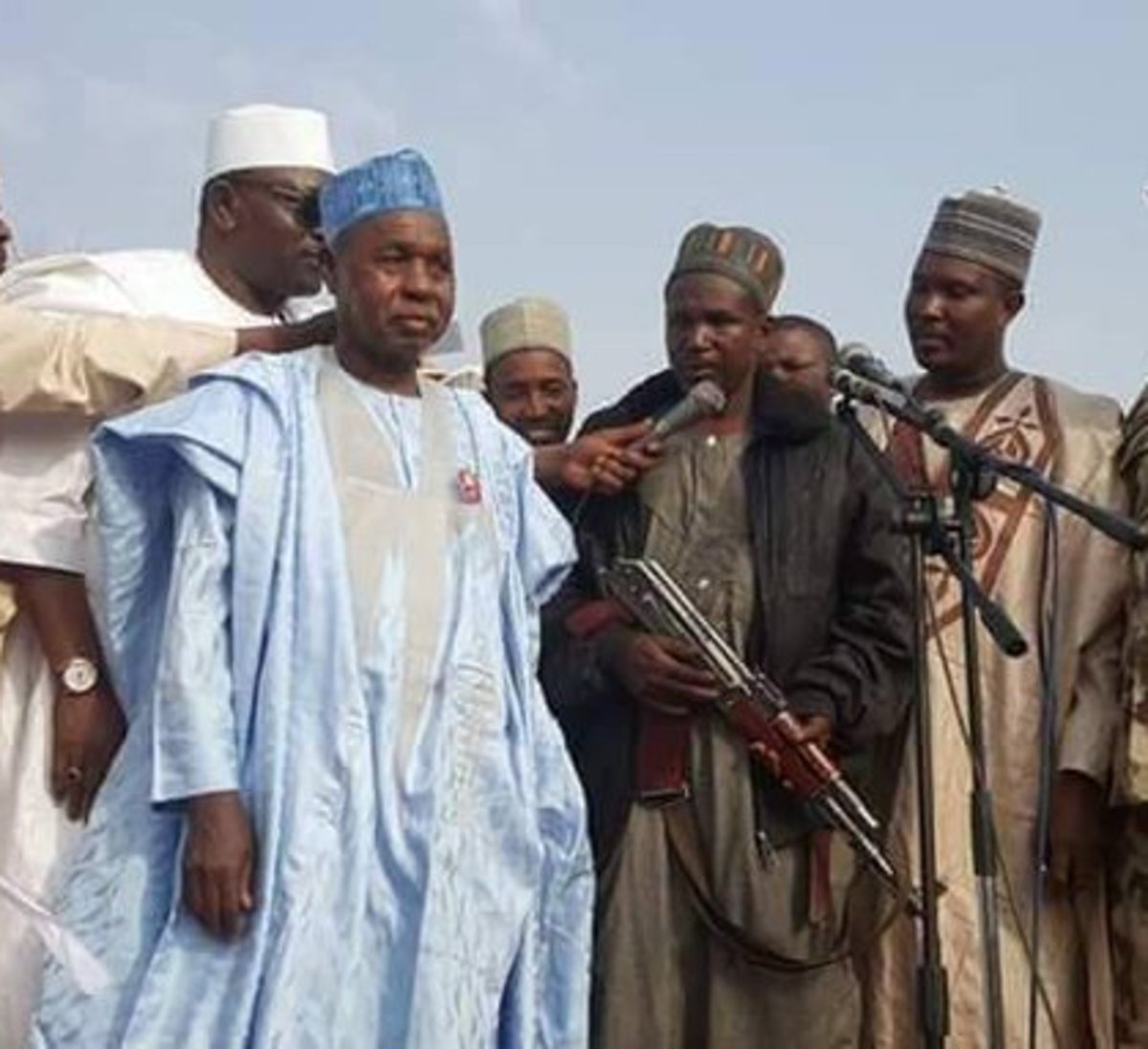 katsina State Governor, Aminu Maigari, poses with a bandits for the cameras during negotiations