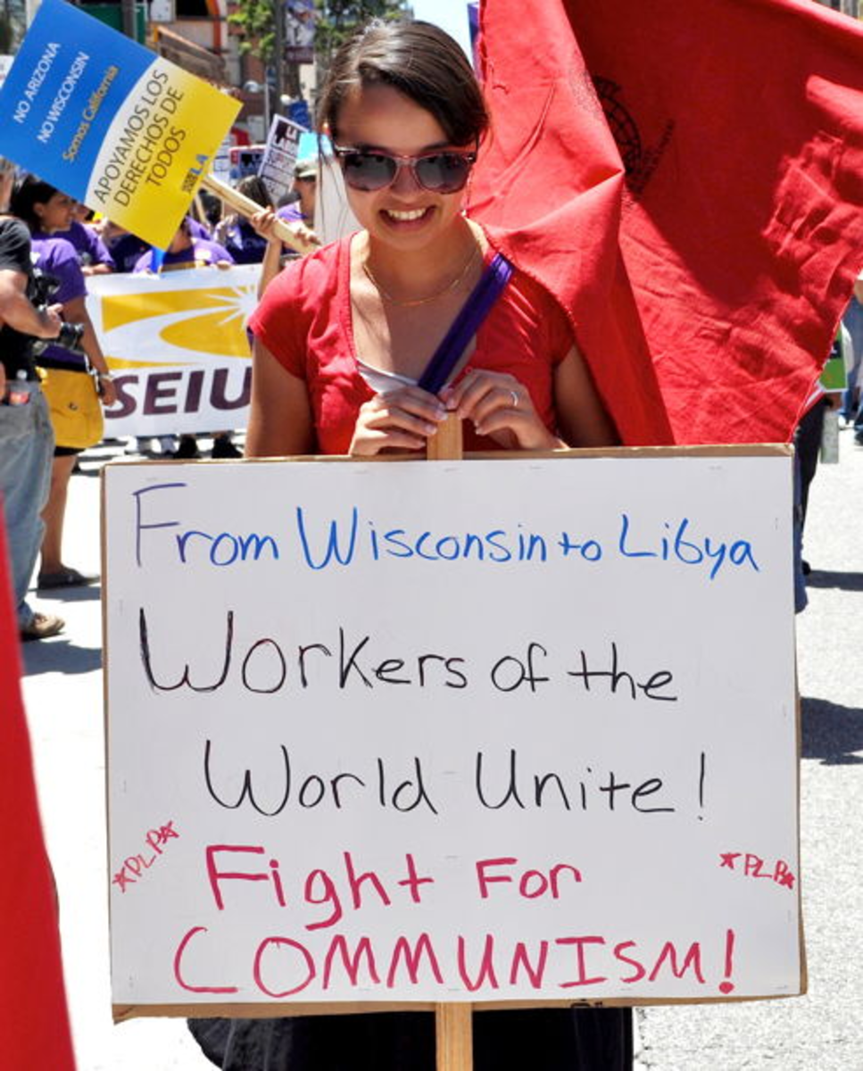 SIGN AT RECENT LABOR UNION RALLY