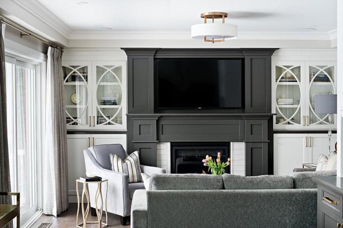 It was choosing the fireplace paint gray color. Choosing the right color styles in the room's den. The painted fireplace color  dramatic to dark gray and authentic.