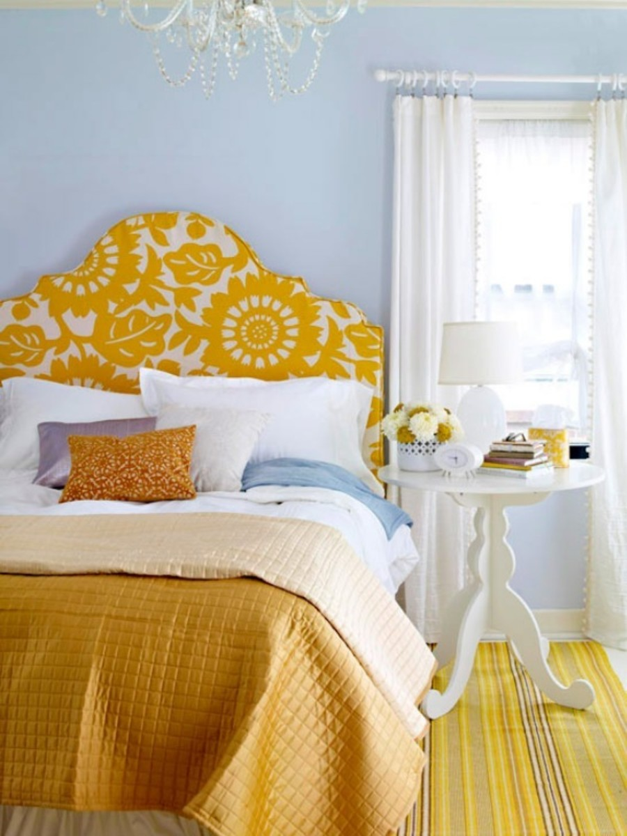 How to make a tufted white and gold fabric headboard that is simple to make. This upholstered (padded) headboard is made of wood board and foam batting and requires stitching or power tools.