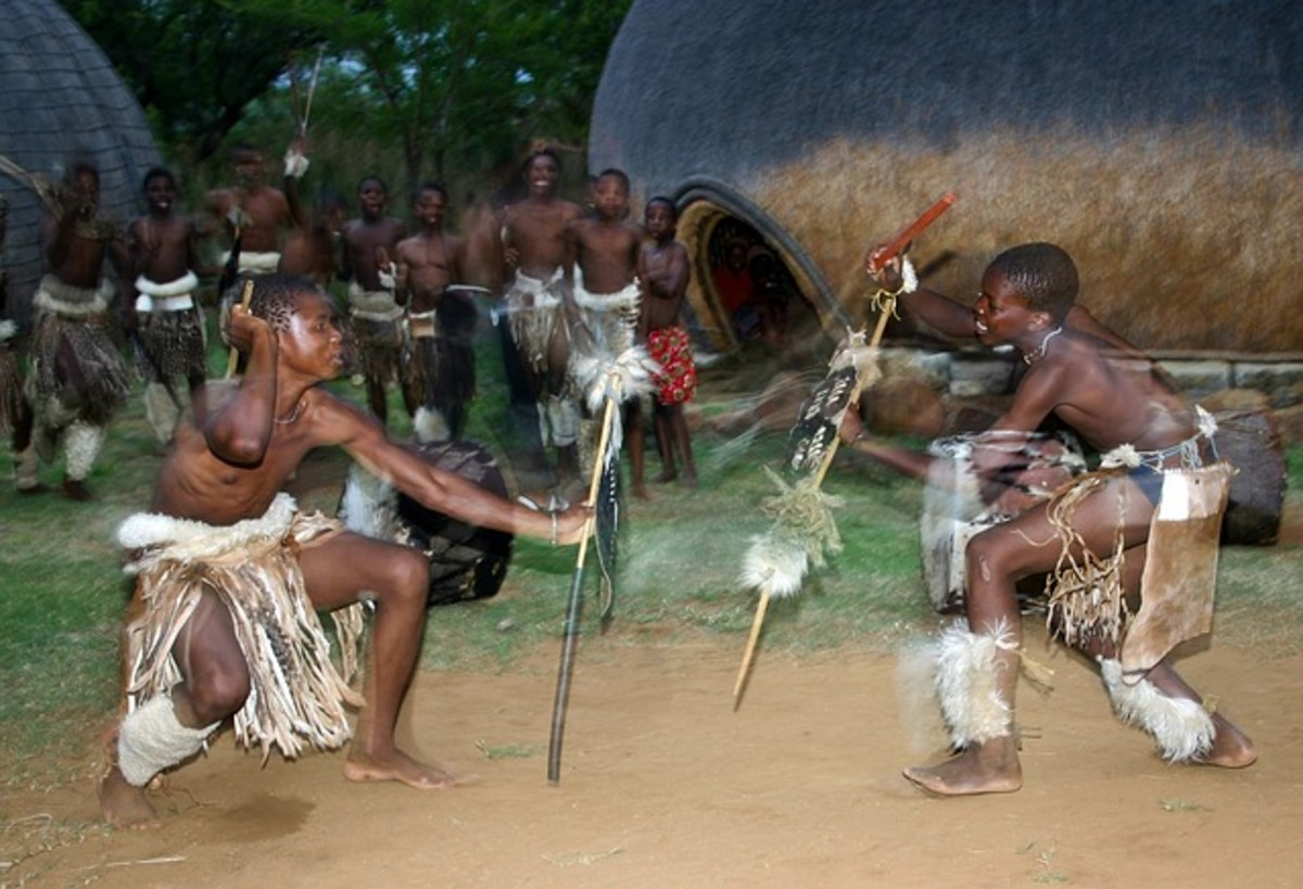 Zulu Dancers portray a stick fight.