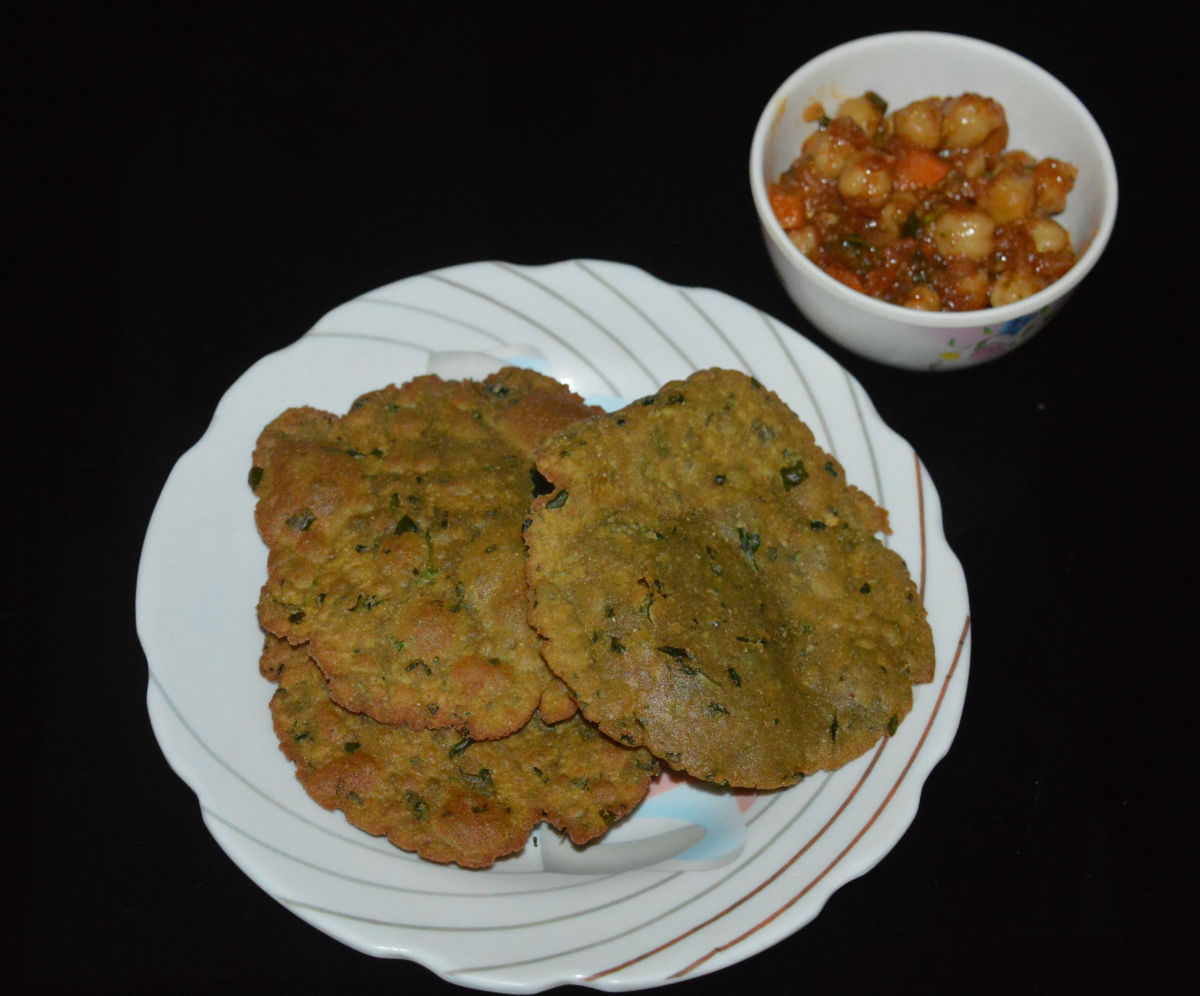 Bajra methi poori served with sweet and mildly spicy chickpea curry
