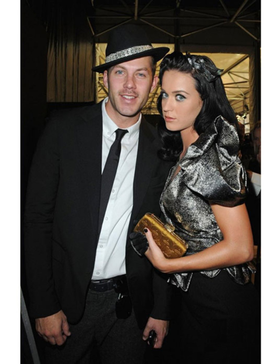 Katy Perry with her gold Louis Vuitton clutch.