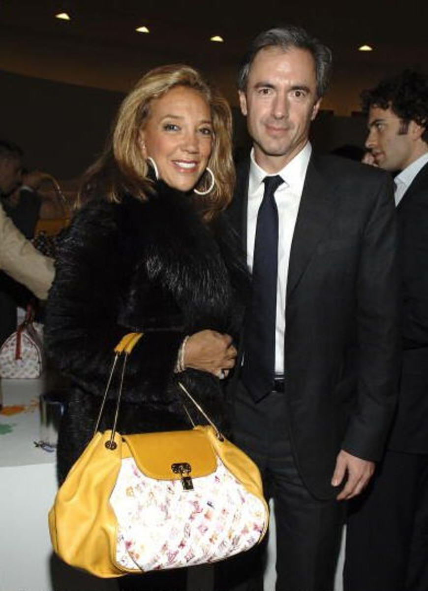 Denise Richards with her mutli-colored Damais bag.