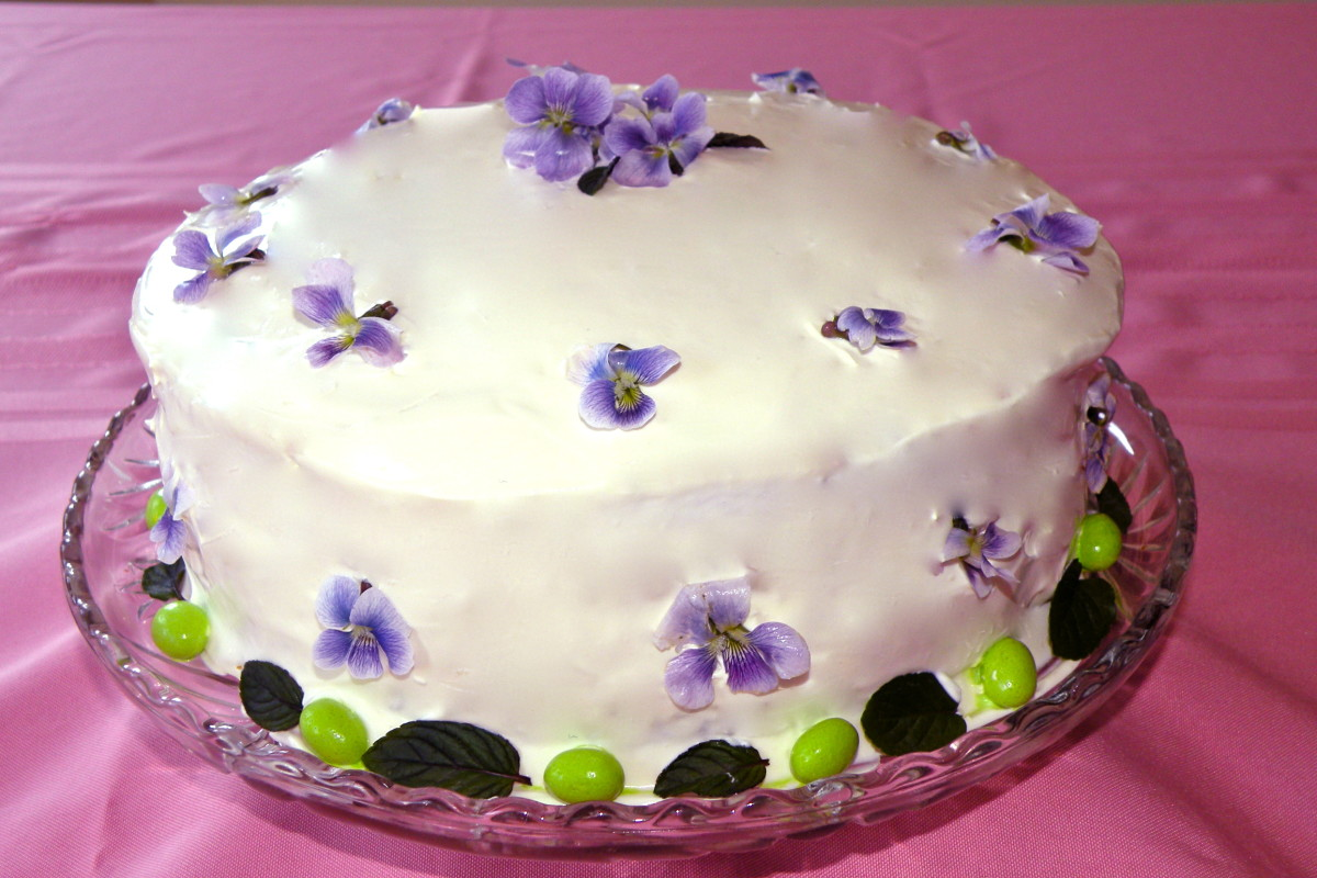 Easter Cake decorated with violets. Mint leaves and jelly beans make the border.