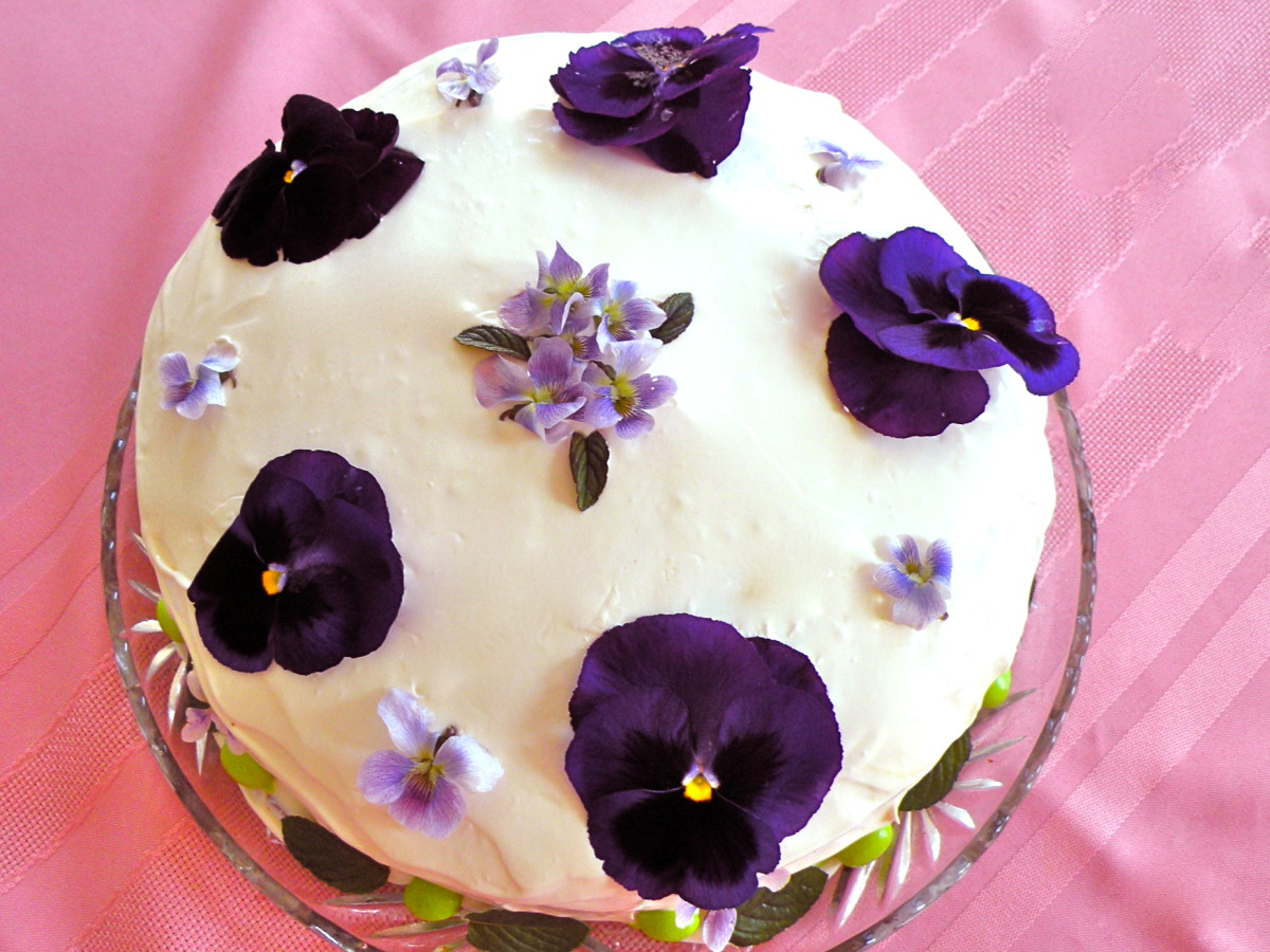 Pansies and violets enhance this special occasion cake.