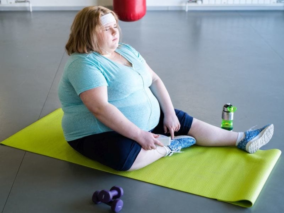 An obese woman (overweight).