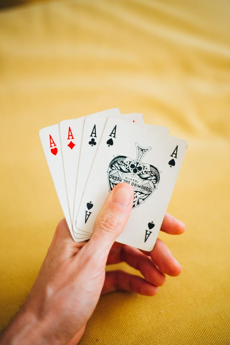 A tablecloth is easy to wash when your fellow card and Mah Jongg players leave. Photo by Oleg Magni from Pexels