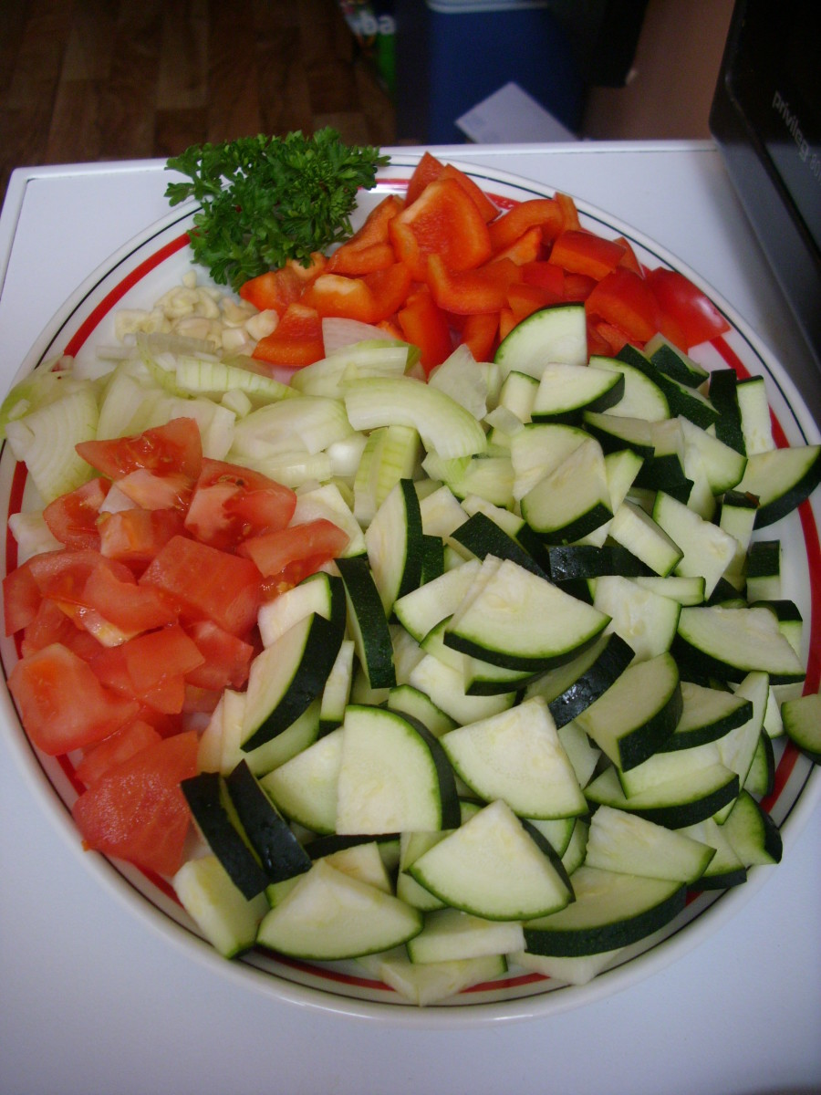 Vegetables for Ratatouille: tomatoes, zucchini, bell peppers, onions, garlic and parsley.