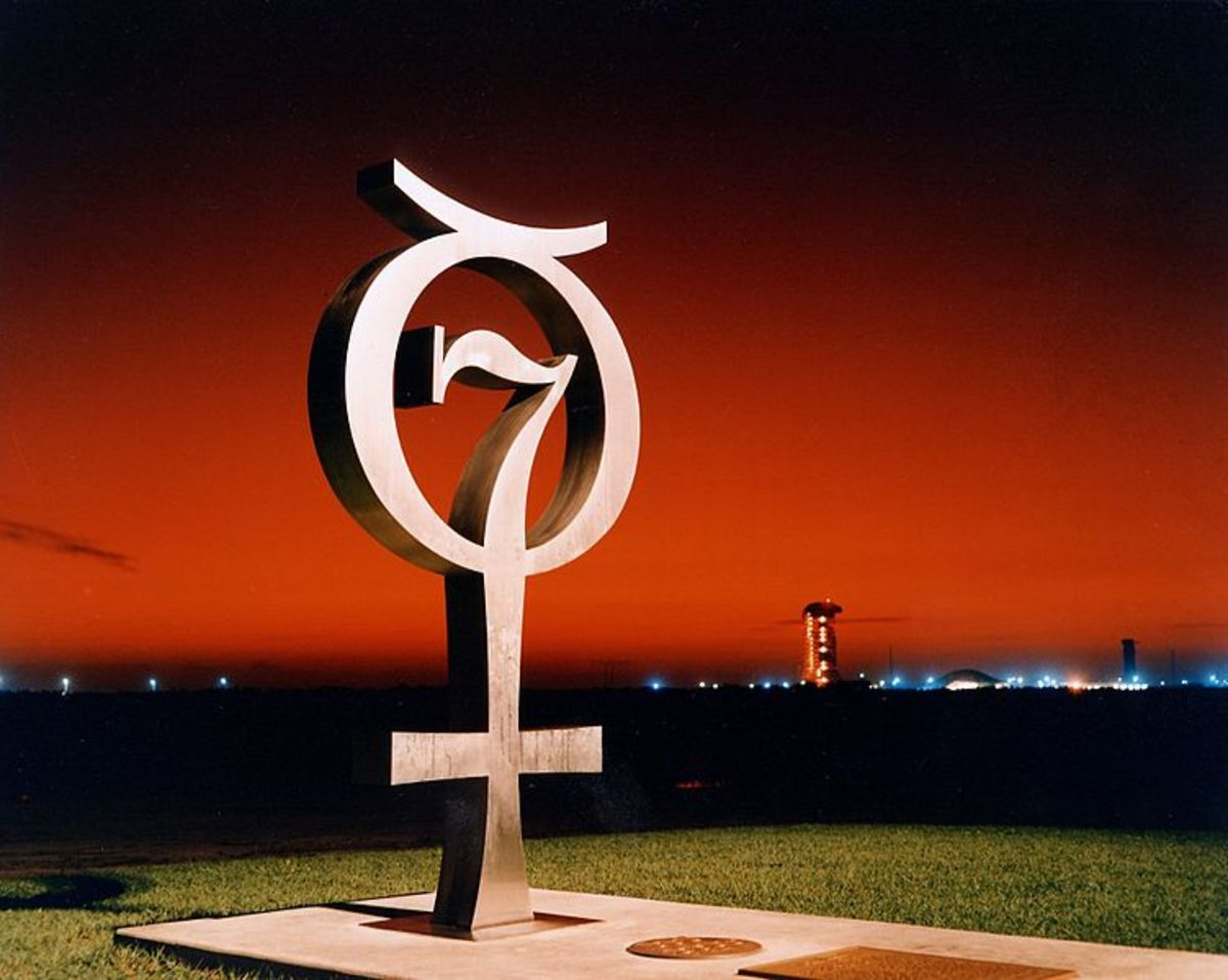 This is a sunrise shot of the Project Mercury Monument that honors the original seven Mercury Astronauts at Pad 14, Cape Canaveral USAF Station. A time capsule is buried beneath the concrete slab.