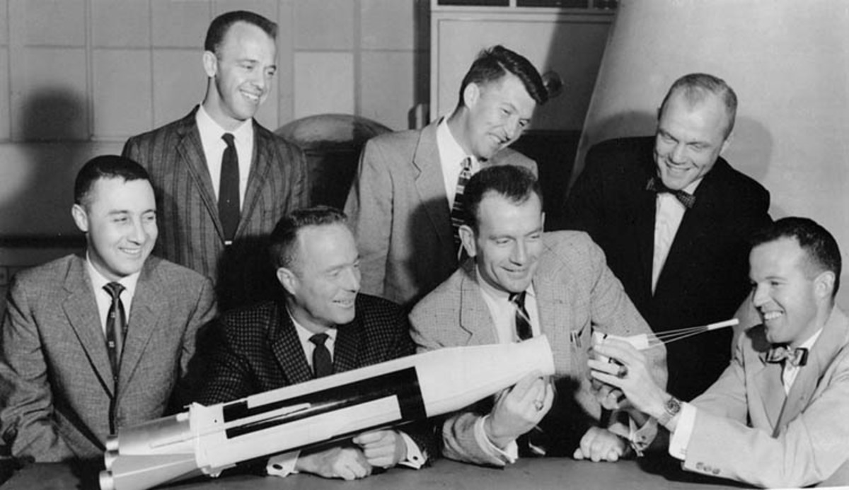 The Mercury 7 Astronauts pose with a model Atlas rocket 7/12/1962. Front Row, left to right: Gus Grissom, Scott Carpenter, Deke Slayton and Gordon Cooper. Back Row: Alan Shepard, Wally Schirra and John Glenn.