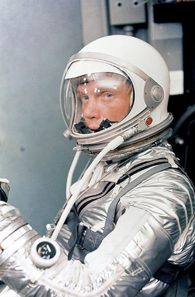 Astronaut John H. Glenn Jr. in his silver Mercury pressure suit , January 1962.