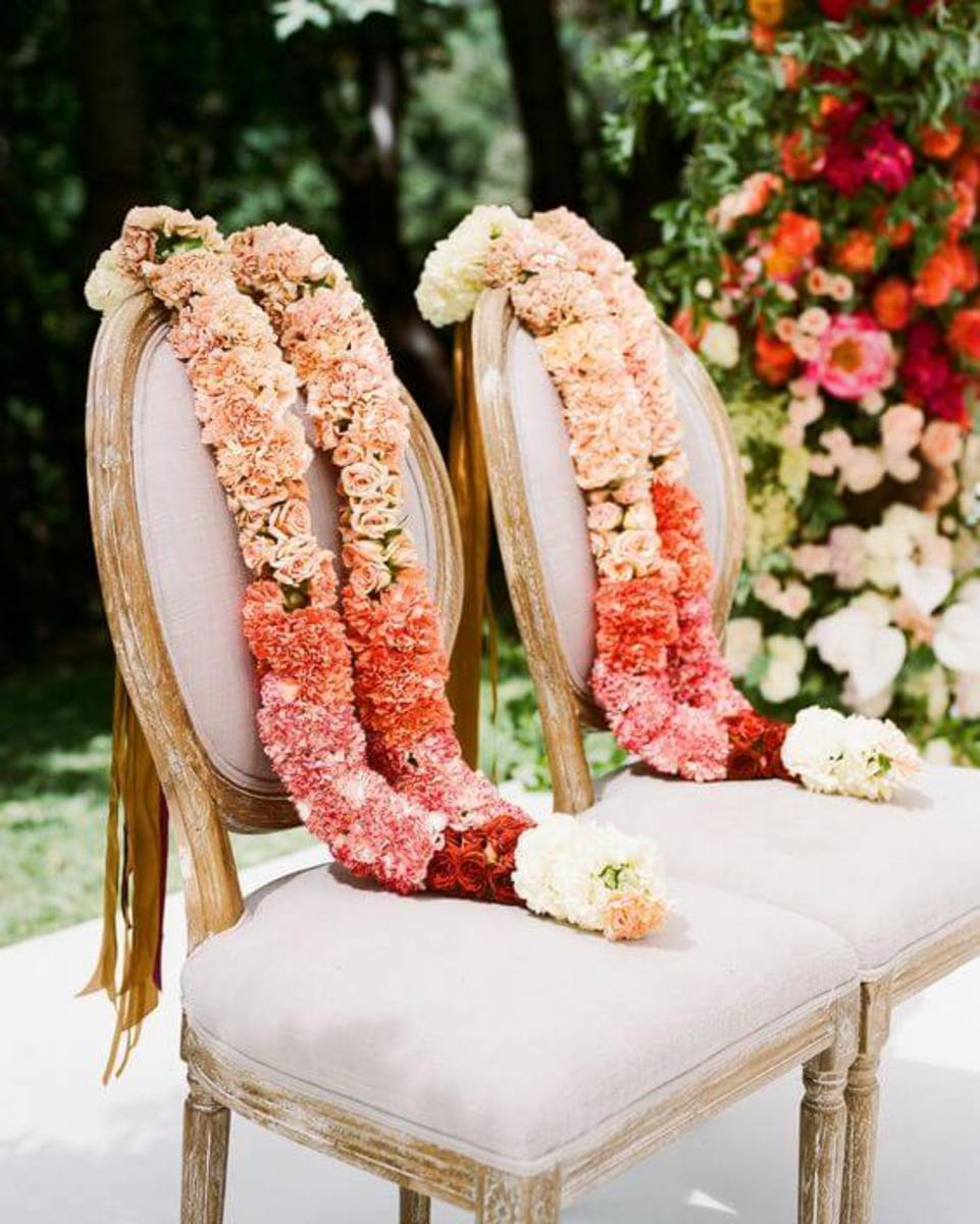 Also known as El Lazo ceremony, this ritual is done by Filipinos, Mexicans, and Spaniards during their weddings. In this ritual, a floral rope will be wrapped around you and your spouse in the form of a number eight figure to represent unity.