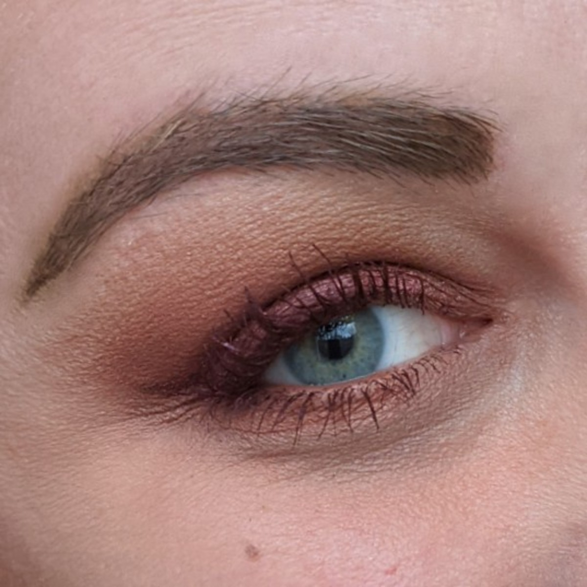 Here's me with a monochromatic red and burgundy makeup look using the Urban Decay Naked Heat Palette and L'Oreal Voluminizing Mascara in Burgundy.