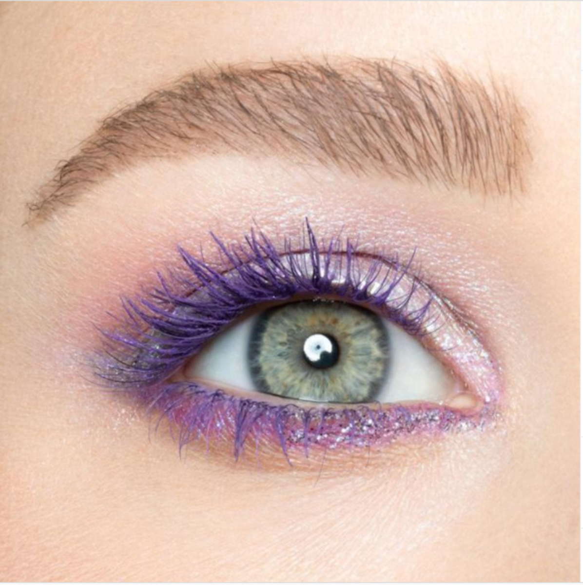 Green eyes with purple mascara.