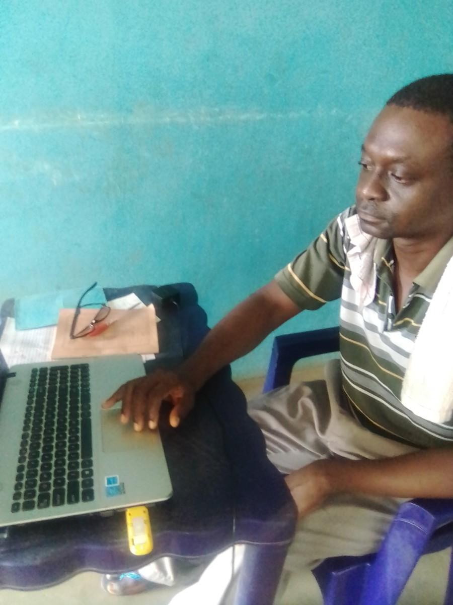 Olusegun, working
