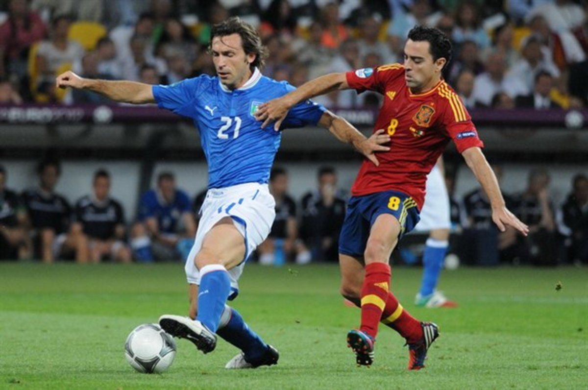Two legends: Xavi (right) kept Andrea Pirlo contained.
