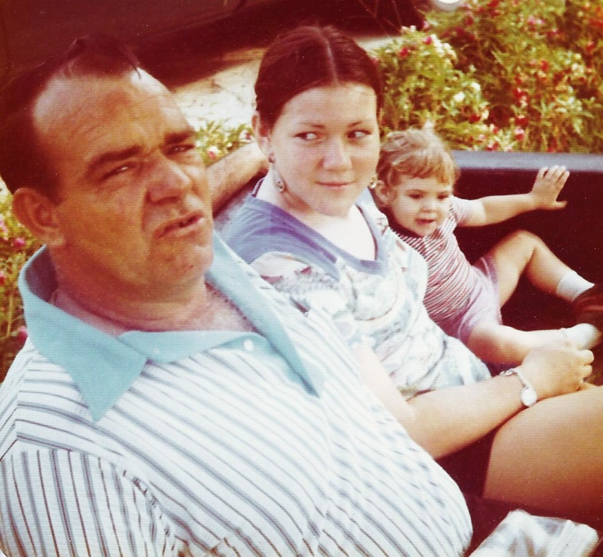 Dad in mid-story with my sister and little niece.