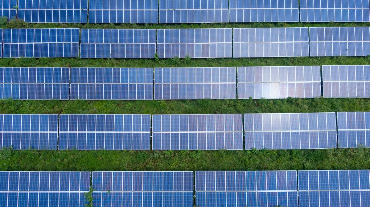 Solar panels connected in series will give a higher voltage output.