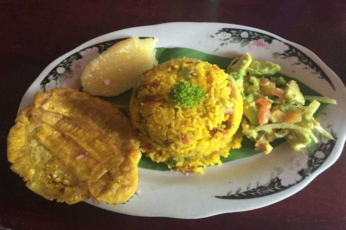 Fish Rice With Salad And Patacon (Fried Smashed Green Plantain). This dish is made with salted, dried mullet.