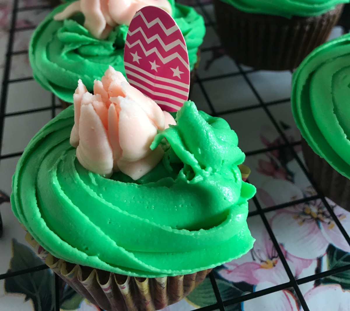 Decorated with green frosting swirl, peach flower and Easter Egg cake pick.