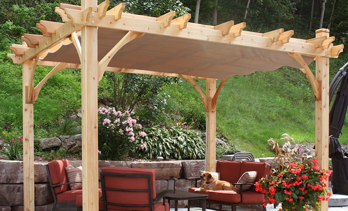 A pergola is in your backyard that helps  enjoy thegarden from the shade.