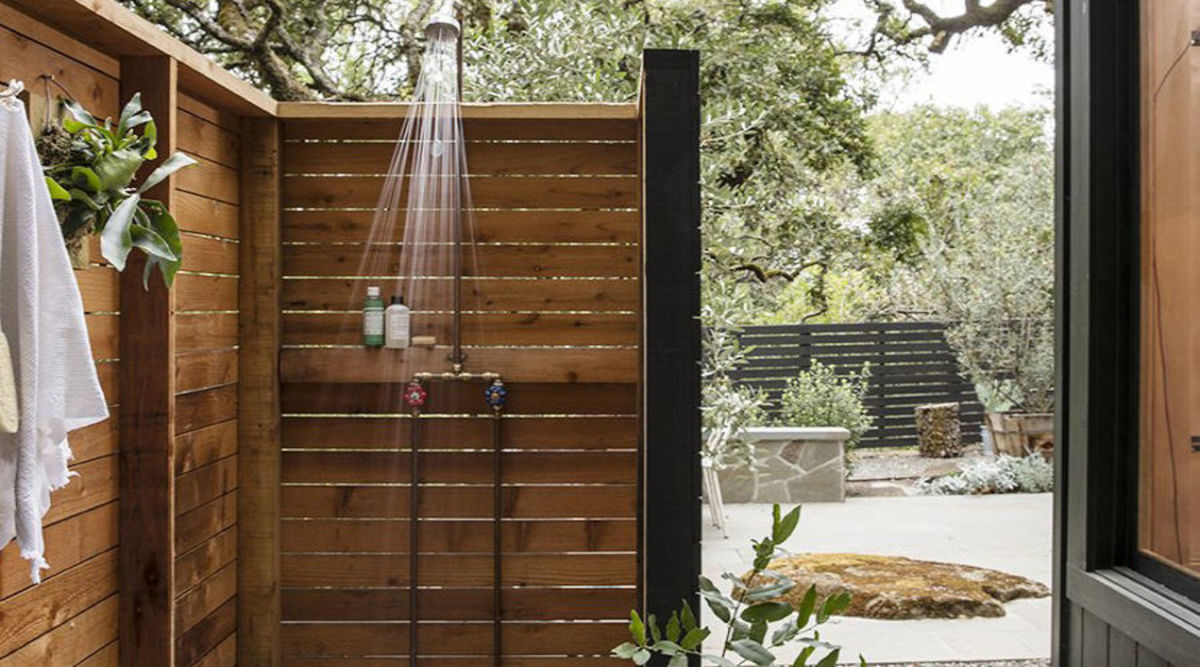 When the wood slat shower like this open-air version. Take a moment to consider your shower. Here, a wood teak behind the pipes makes for a  shelf for soap and shampoo.